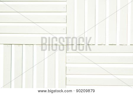 Batten of white wood for background.