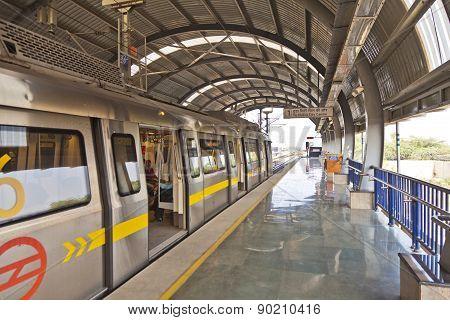 Delhi - November 11: Passengers In Metro Station With Arriving Train On November 11, 2011 In Delhi,