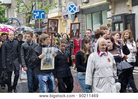 Donetsk - May, 9, 2015: Citizens With Portraits Of Family Members - Participants In The Second World