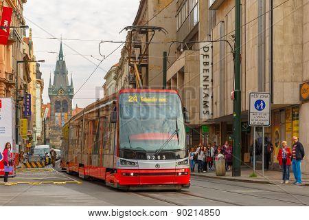 Red tram near Jindrisska Tower in Prague, Czech