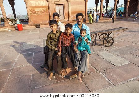 Father With His Children Rests On Courtyard Of Jama Masjid Mosque In Delhi
