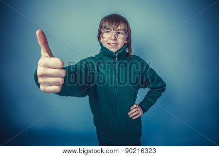 teenager boy brown hair European appearance in green sweater wit