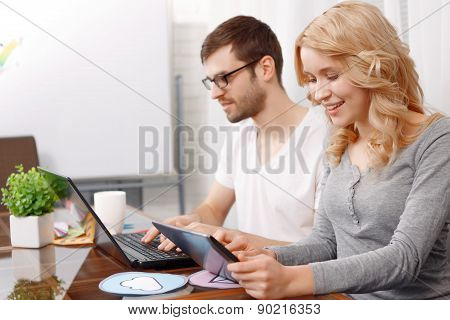 Portrait of a young developer and his female colleague