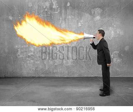 Angry Businessman Screaming Into Megaphone Spitting Fire With Concrete Indoor