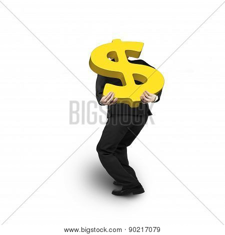 Businessman Carrying Gold Dollar Sign Isolated On White