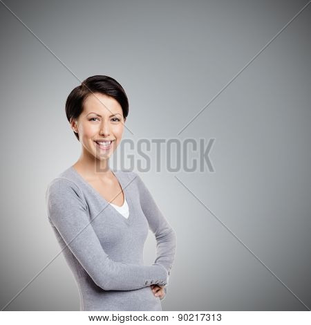 Smiley young woman, isolated on grey
