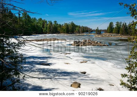 Melting Snow Covered Bay In Canadian Spring Wilderness
