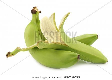 fresh still unripe  bananas and a peeled one on a white background