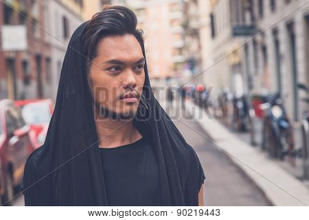 Handsome Asian Model Posing In The City Streets