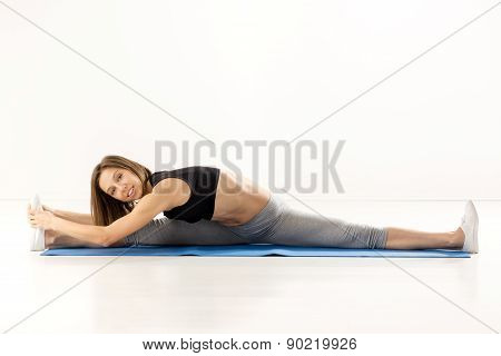 Cute Girl Doing Stretching Exercise