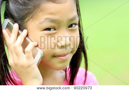 Close Up Portrait Of Asian Girl Talking Mobile Phone