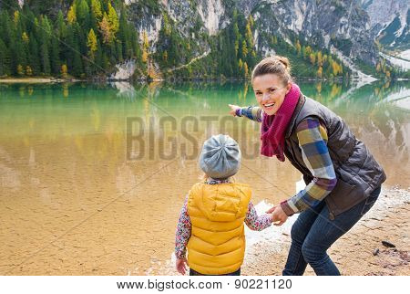 Mother And Daughter Playing On The Shore Of Lake Bries