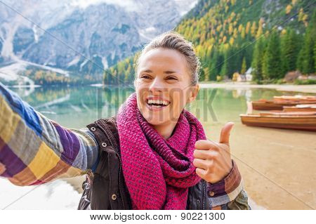 Thumbs Up Selfie By Smiling Woman At Lake Bries