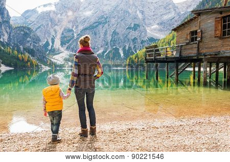 Mother And Daughter Holding Hands On Lake Bries
