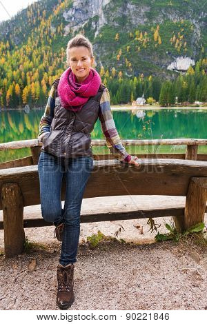 Woman Hiker Rests At Edge Of Lake Bries With Pink Scarf