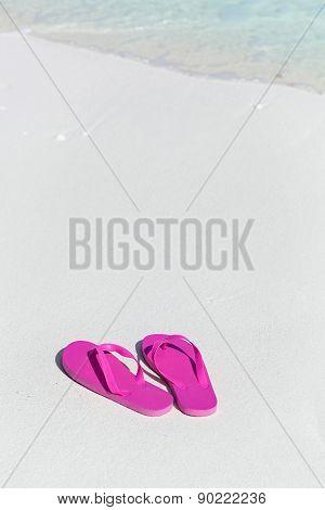 Pink Flip Flops On Sandy Beach