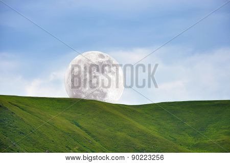 Moon Above Green Slope