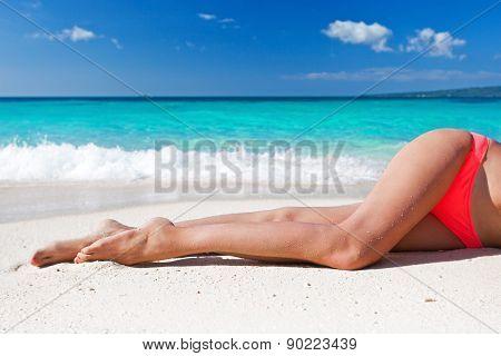 Tan Slim Legs On Beach