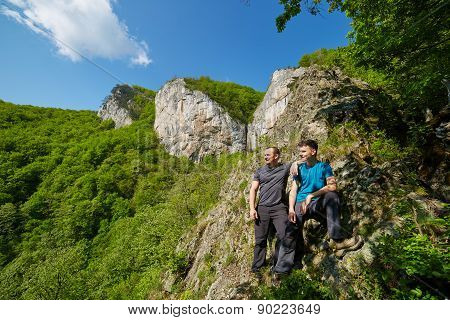 Father And Son Posing On The Mountains