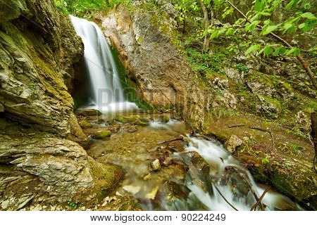 Waterfall On A Mountain River