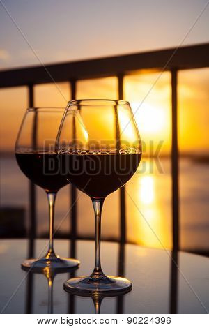 Two Glasses With Red Wine In Sunset