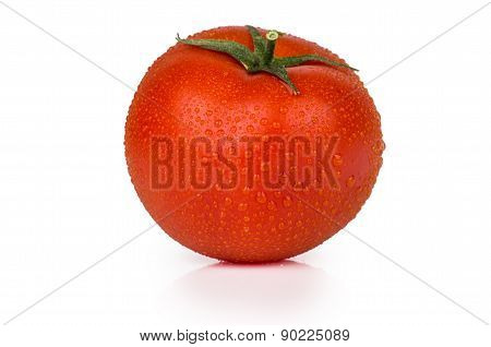 Single Tomato In Water Droplets Isolated On White