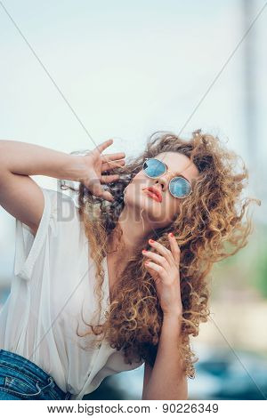 Beauty Girl Outdoors enjoying nature. Beautiful Teenage Model girl with long healthy blowing hair ru