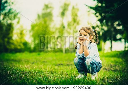 Happy Little Pretty Girl Outdoor In The Park