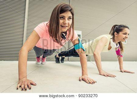 Couple Of Girls Making Push Ups Training