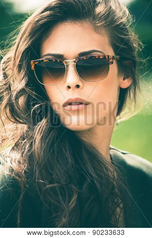 young  urban woman with sunglasses in the park portrait