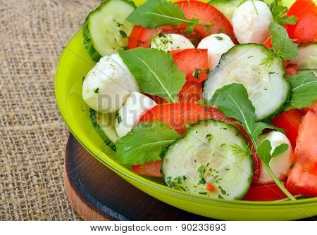 Fresh Salad With Mozarella Cheese, Tomatos, Cucumber And Arugula Leaves