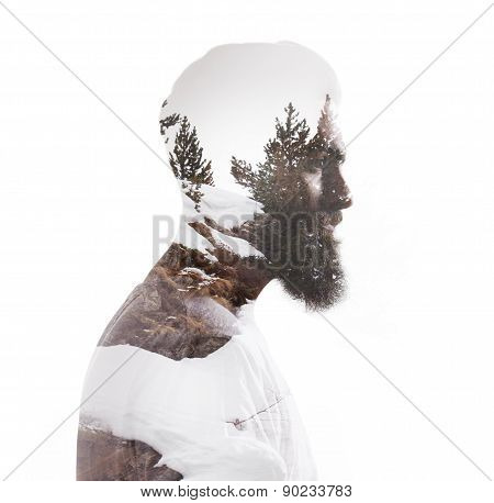 Double exposure portrait of a bearded guy and tree