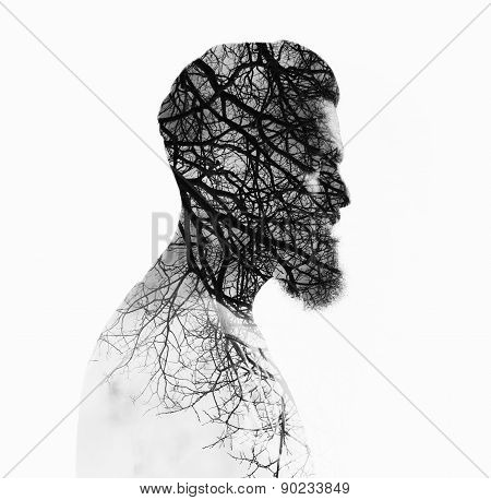 Double bw exposure portrait of a bearded guy and tree