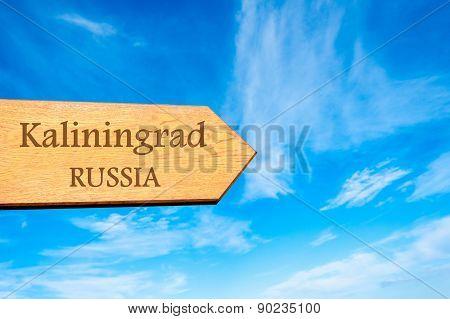 Wooden arrow sign pointing tourist destination