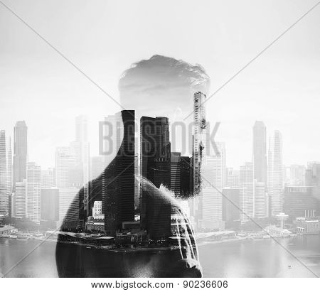 BW double exposure of young man