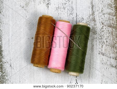 Spools Of Thread On Rustic White Wood