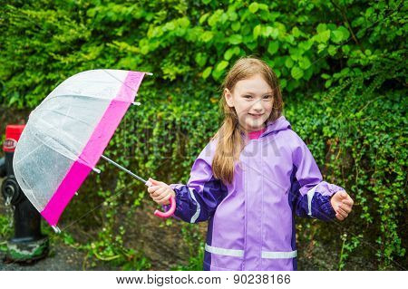 Pretty little girl under the rain