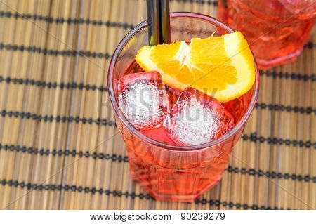 Top Of View Of Spritz Aperitif Aperol Cocktail With Orange Slices And Ice Cubes