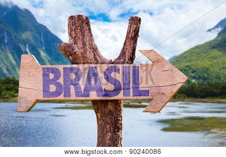 Brazil (in Portuguese) wooden sign with mountains background