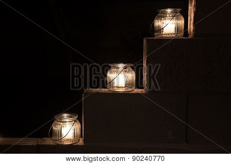 Jar Lights On Steps In Darkness