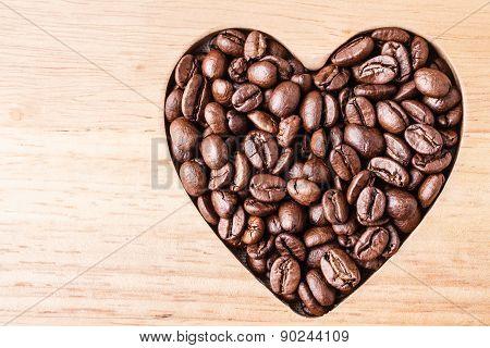 Heart Shaped Coffee Beans On Wooden Board