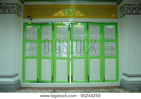 Timber door with traditional craft at Abidin Mosque in Kuala Terengganu, Malaysia