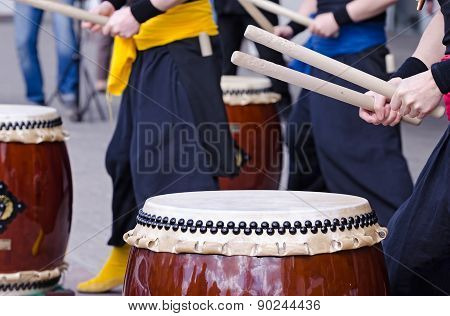 Group of musicians are playing on traditional japanese percussion instrument Taiko or Wadaiko drums