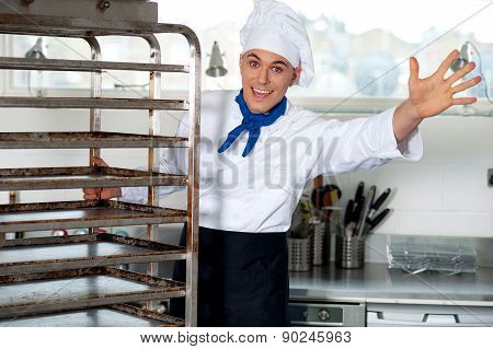 Portrait Of A Chef Moving Tray Rack