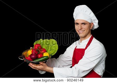 Young Chef Holding Colander With Fresh Vegetables