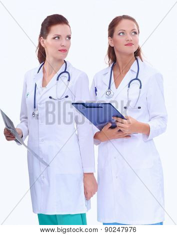 Two woman nurse watching X Ray image , standing