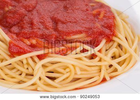 Macro image of ketchup and pasta.