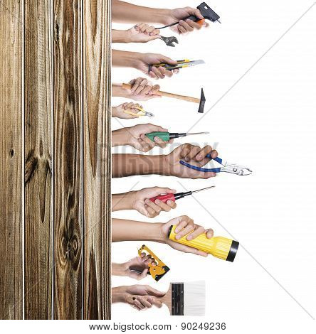 Hands with construction tools. House renovation background
