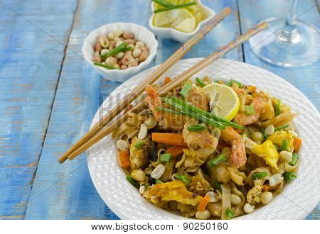 pad thai rice noodles with chopsticks
