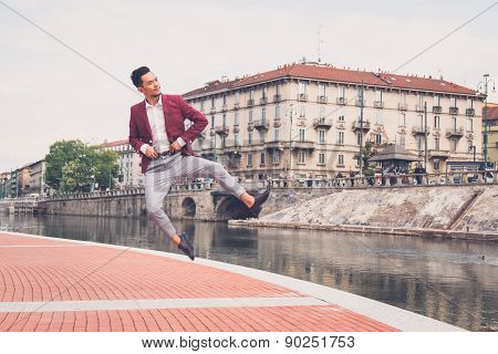 Handsome Asian Model Jumping By An Artificial Basin